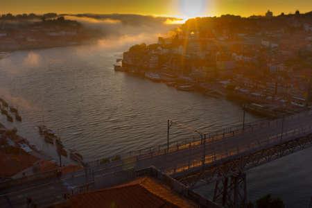 Porto, Portugal sunset over the Douro River and Dom Louis Bridge.