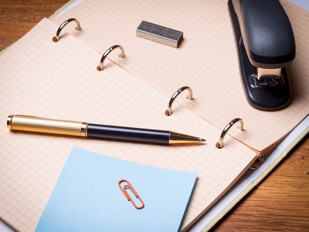 office stapler: Notebook, pen, stapler and some other stationery