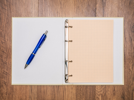 scratchpad: Notebook and pen lying on the table