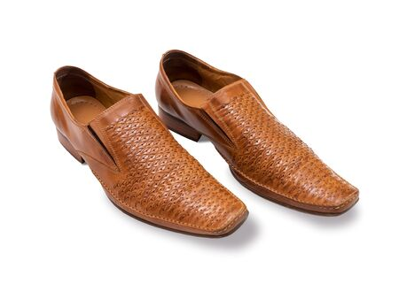 footgear: Orange biege mens shoes on a white