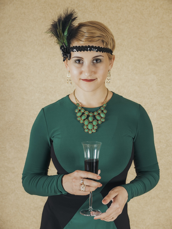 ladylike: The girl dressed in the fashion of Chicago 30s with the glass of wine