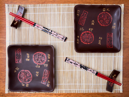 japanese cookery: Bamboo mat, plates and chopstick on the table