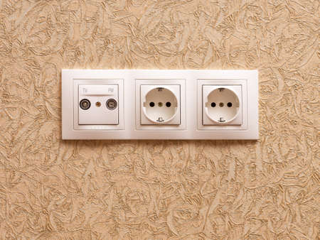 receptacle: Two electric outlets and sockets for television and radio