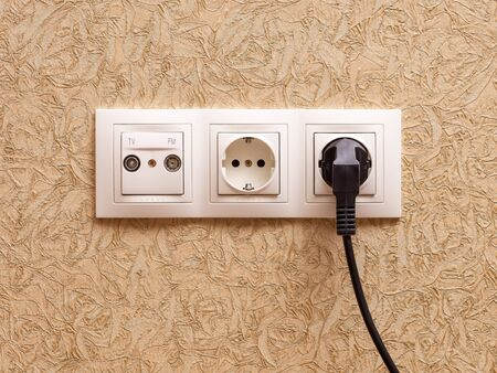 sockets: Two electric outlets with plug and sockets for television and radio