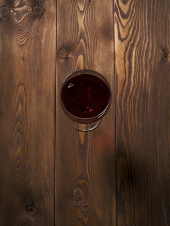Glass of red wine on the wooden table. Top view Stock Photo