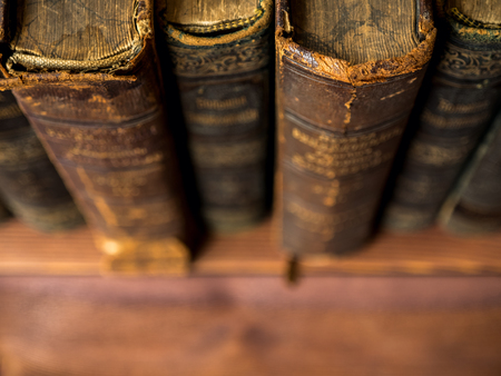 antique books: Pile of old antique books on the table. Shallow focus Stock Photo