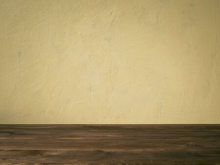 biege: Background image of the biege concrete wall and wooden table