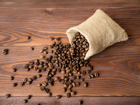coffea: Bag with coffee beans on the wooden table