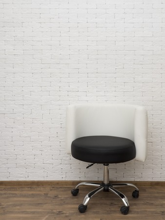 swivel: Swivel chair on a background of a brick wall