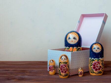 matrioshka: Russian matrioshka on the wooden table. Front view