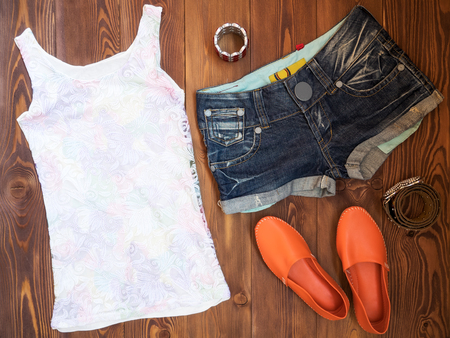 Summer clothes on wooden background. View from above Stock Photo