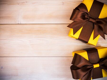 Composition of packed present boxes on wooden board. Celebrations concept Reklamní fotografie