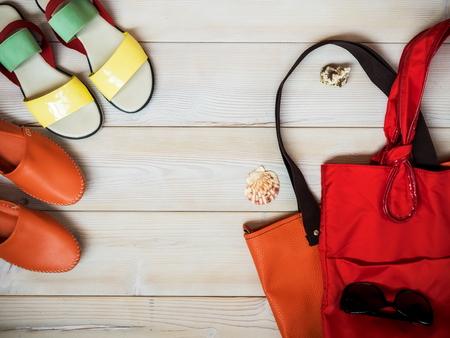 go shopping: Beach accessories on wooden background. Holidays concept. View from above Stock Photo