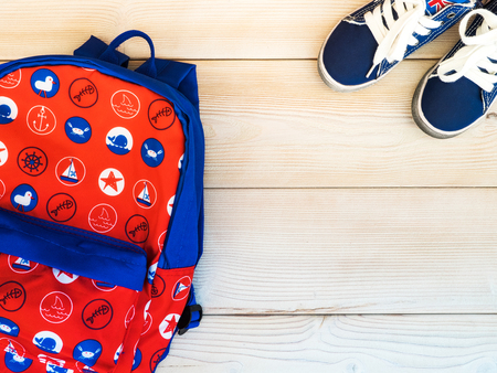 children crab: Childrens backpack on the wooden board. Nautical theme. View from above