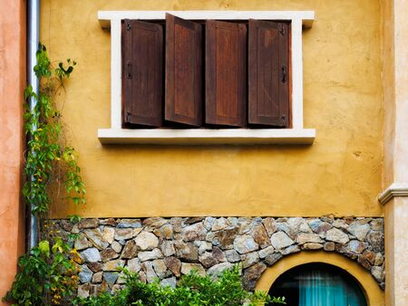 View of stone wall texture background with window