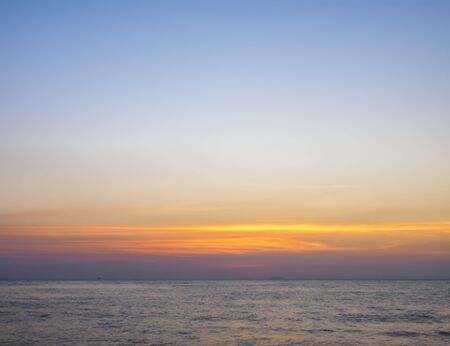 Yellow-red sunset sky above the sea Stock Photo