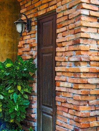 Brick wall with the wooden door in it