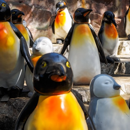 Figures of the penguins in the summer park Stock Photo