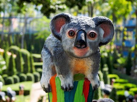 Statuette of the koala in the summer park