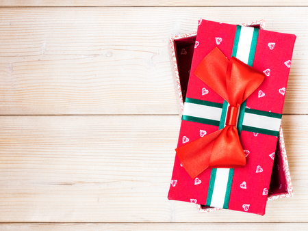 Red gift box on wooden board. Copy space. Holidays concept Stock Photo
