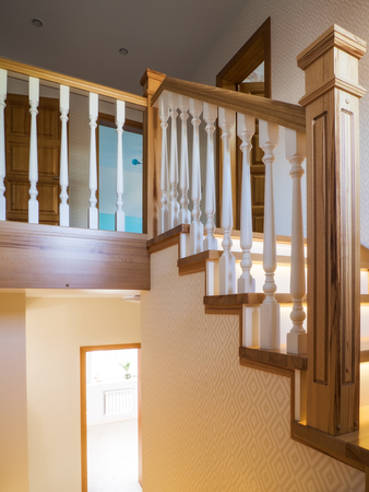 Home interior. Staircase with wooden steps and balustrade Stock Photo