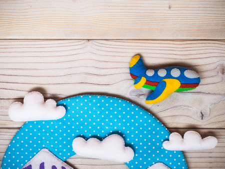 Childrens handmade toys from felt on the wooden background