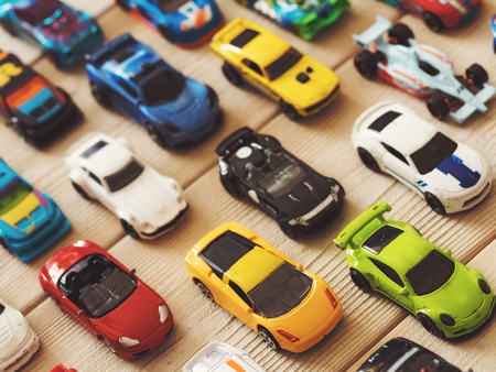 Toy cars on the wooden floor. View from above