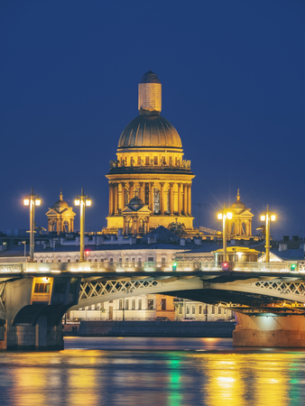 Blagoveschensky or Annunciation Bridge and Saint Isaac Cathedral at night. Saint-Petersburg, Russia