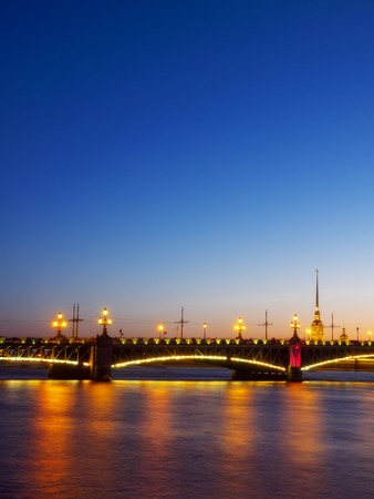 Peter and Paul Fortress and Trinity Bridge at night. Season of white nights. Saint-Petersburg, Russia