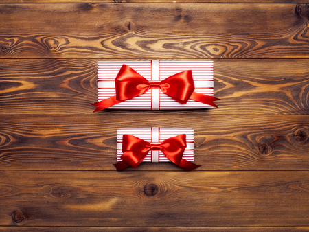 Composition of packed present boxes on wooden board. Celebrations concept Stock Photo