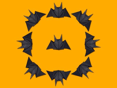 Halloween background. Origami bat pattern. View from above
