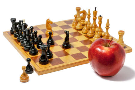strategical: Chess board with figures and a red apple