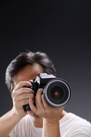 stock image of the photographer focusing and taking picture photo