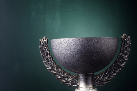 Trophy cup isolated on the green background. photo