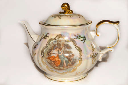 stand teapot: Vintage porcelain teapot with a pattern and gilding