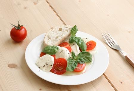 delicious italian salad with mozarella, tomato and basil