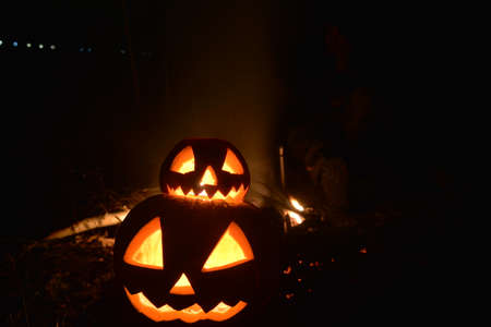 two halloween pumpkins with fire background