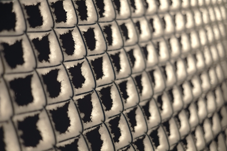 metal mesh: Closeup Snow On A Chain Link Fence Stock Photo