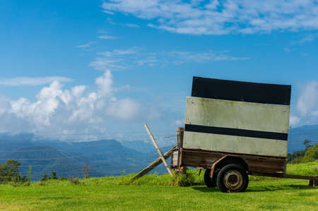australian outback: Cart with clear billboard against rural background. Rural scene with copy space. Creative rural advertising in Australian outback Stock Photo