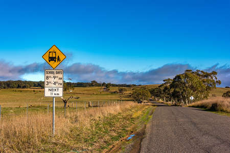 nsw: Australian outback road with school bus stop sign. Unmarked rural path. Myrtleville NSW, Australia