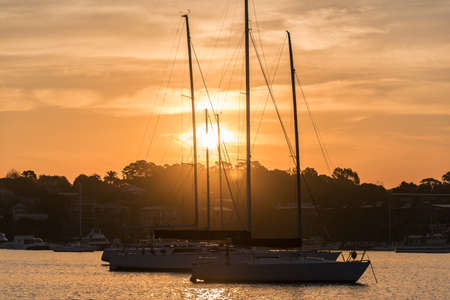 motorboats: Beautiful Gunnamatta Bay sunset view with sailboats, yachts and motorboats. Harbour lifestyle scene
