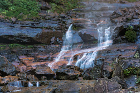Wentworth Falls lower section, waterfall cascade. Water flowing over rocks. Wentworth Falls, Blue Mountains National Park, Australia Stock Photo