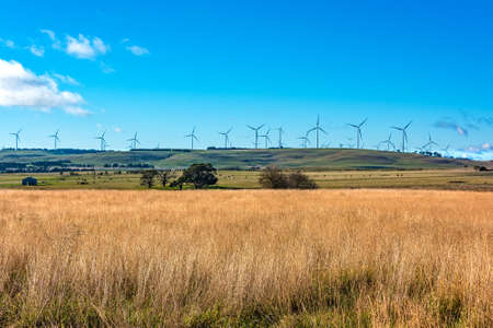 Windmill electricity turbine with rural outback background. Farmland and wind turbines. Myrtleville, NSW, Australia