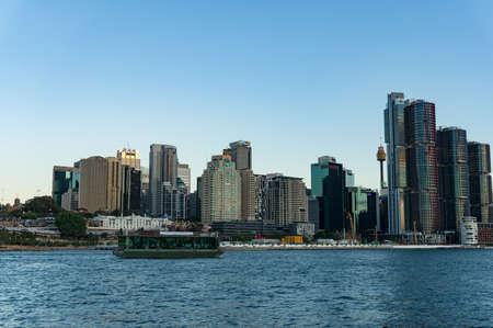 Sydney, Australia - November 13, 2016: Sydney CBD cityscape with Barangaroo point and Koala cruises boat with tourists at dusk