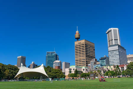 public domain: Sydney, Australia - November 24, 2016: Sydney Domain, public space with tent stage and Sydney CBD skyline on the background
