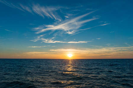 sea scape: Sunset landscape with sea and colorful clouds. Nature seascape background with copy space