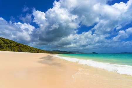 whitehaven beach: Beautiful tropical beach with picturesque cloudscape. Summer holiday, vacation background. Whitehaven beach on Whitsunday island, Queensland, Australia Stock Photo