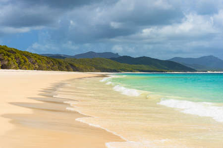 whitehaven beach: Beautiful tropical beach with white foam sea wave. Turquoise waters and silica white sand of Whitehaven beach. Queensland, Australia Stock Photo
