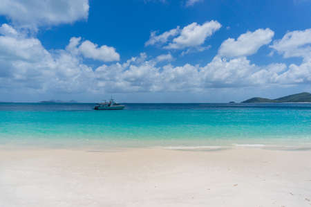 whitehaven beach: Cruise boat, ship with tropical beach on foreground. Summer cruise vacation