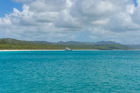 whitehaven beach: Cruise liner, ship in tropical sea with exotic island on the background. Whitehaven beach, Whitsundays, Queensland, Australia